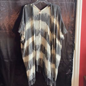 Free People cape with fringe on the bottom